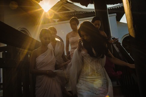 A bridal party prepare for a ceremony at InterContinental Sun Peninsula Resort, Danang, Vietnam. Photo: Wainwright Weddings